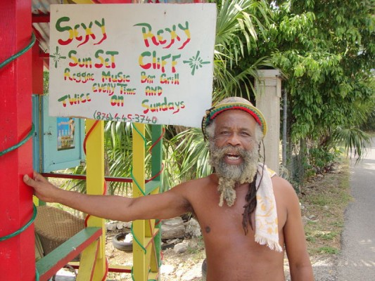 Tour Guide Sexy Rexy beside his bar in Negril, Jamaica