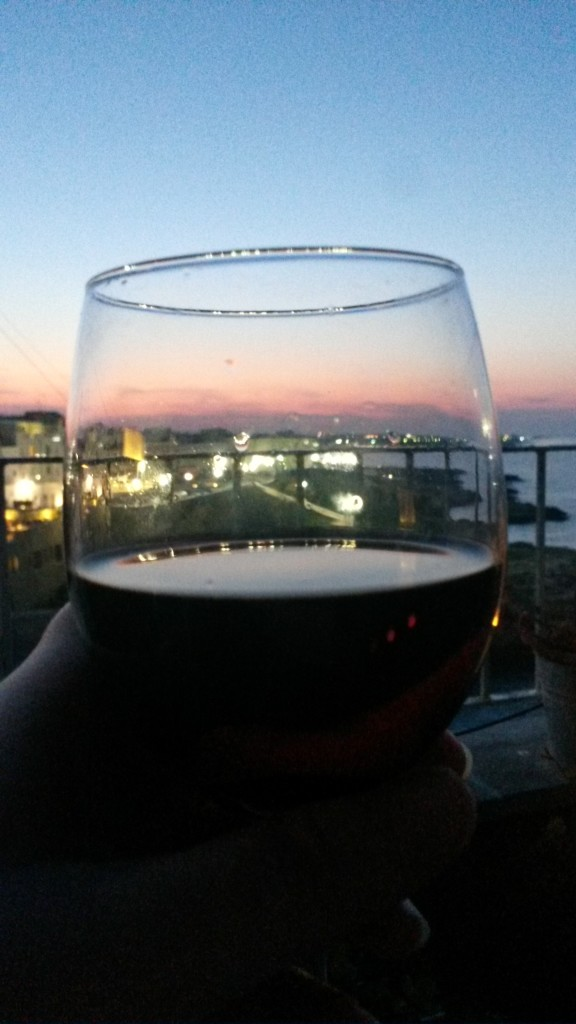 Wine on the balcony at Poligano a Mare